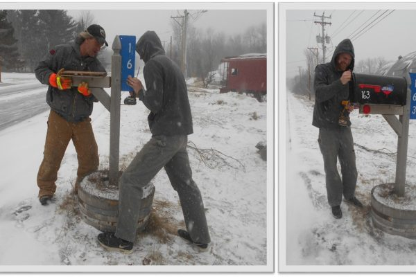 Repairing mailbox in the snowstorm